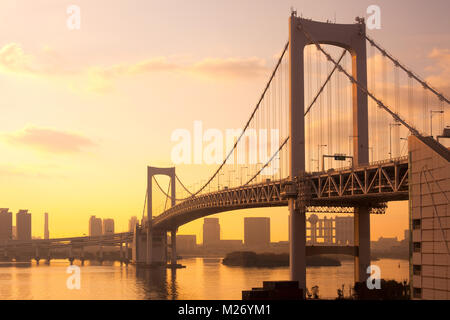 Rainbow Bridge and skyline of Odaiba, Tokyo, Kanto Region, Honshu, Japan - Stock Photo