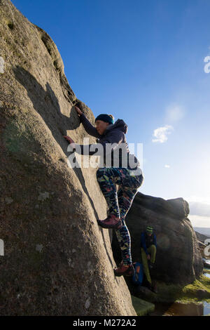 Female climber, Burbage Edge, Peak District, Derbyshire, Sheffield, England, UK - Stock Photo