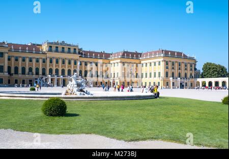 Austria, Vienna,  The main facade of the Schonbrunn Palace with a fountain in the foreground - Stock Photo