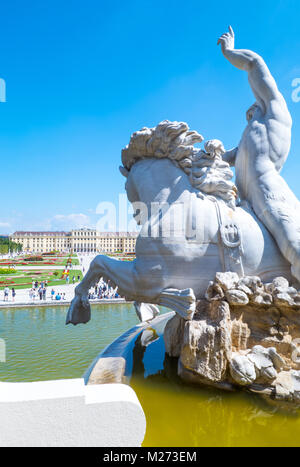 Austria, Vienna,  The garden and the rear facade of the Schonbrunn Palace seen from the Neptune fountain - Stock Photo