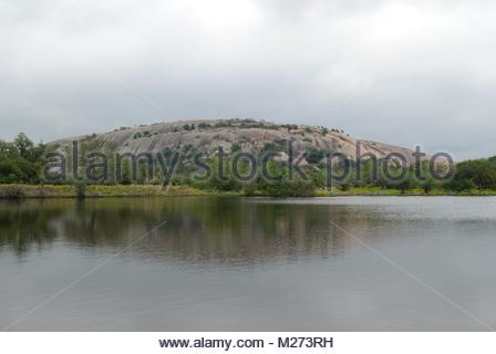 Cloudy Day at Enchanted Rock. This pink granite exfoliation dome is the centerpiece of Enchanted Rock State Natural - Stock Photo
