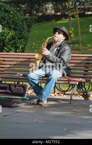 Madrid, Spain -- Nov 3, 2017: Street musician in park - Stock Photo
