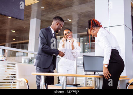 young woman surprised by new car, gift for my beautiful wife - Stock Photo
