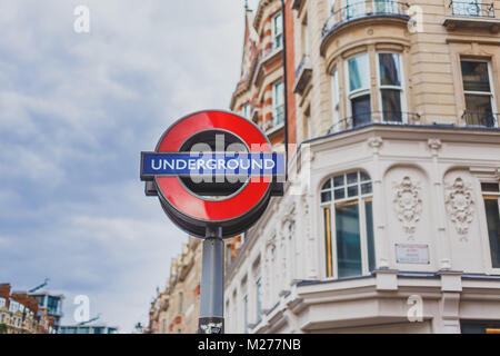 LONDON, UNITED KINGDOM - August 15th, 2014:Underground street sign in London city centre with building bokeh - Stock Photo
