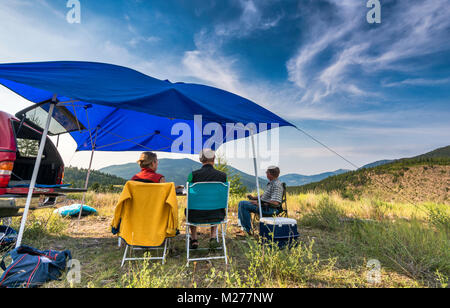 Middle aged campers at Brewer Creek Forest Service Road, Purcell Mountains, near Invermere, British Columbia, Canada - Stock Photo