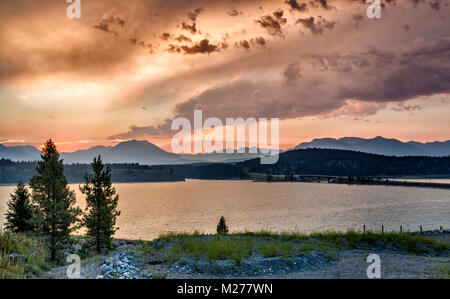Lake Koocanusa, a reservoir on Kootenay River, Canadian Rockies in distance, at sunrise, East Kootenay Region, British - Stock Photo