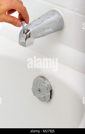 Demonstration of how the water tap is working in a bathroom - Stock Photo