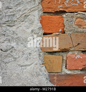 Red bricks stone wall background closeup, cracked ruined stucco, vertical plastered grunge grey beige stonewall - Stock Photo