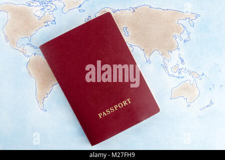 The passport is on the world map. Symbolizes travel, vacation - Stock Photo