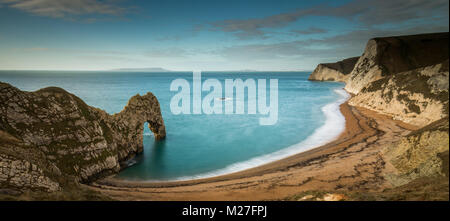 Durdle Door a natural limestone arch on the Jurassic Coast in Dorset - Stock Photo