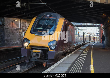 A Class 221 Super Voyager train stands at Motherwell before departing for Bristol Temple Meads. This unit, 221133, - Stock Photo