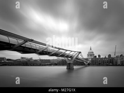 The Millennium Footbridge and St Paul's Cathedral - Stock Photo