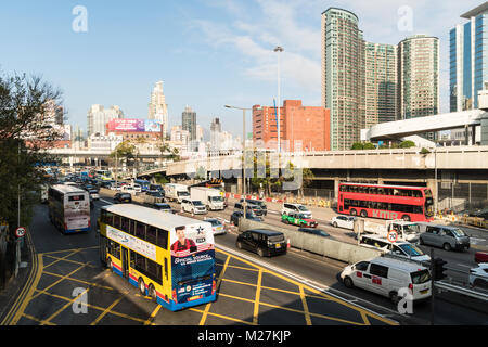 Hong Kong - January 25 2018: Heavy traffic on the crowded road leading to and from the Cross harbour tunnel in Hung - Stock Photo