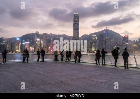 Hong Kong - January 25 2018: People taking picutre and enjoying the view from the top of the Ocean cruise terminal - Stock Photo