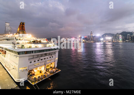 Hong Kong - January 25 2018: A large cruise ship anchored at the Ocean cruise terminal in Kowloon wiht the Hong - Stock Photo