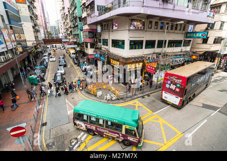 Hong Kong - January 25 2018: Aerial view of a minibus driving in the crowded streets of Mong Kok in Kowloon, Hong - Stock Photo