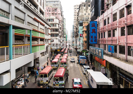 Hong Kong - January 25 2018: High angle view of minibuses waiting in the crowded  streets of Mong Kok in Kowloon, - Stock Photo