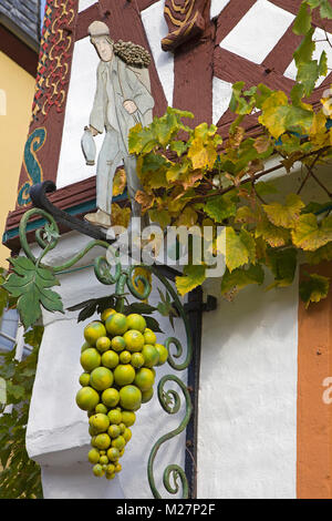 Vintner and grapes, decoration at inn sign of a wine tavern, wine village Ediger-Eller, Moselle river, Rhineland - Stock Photo