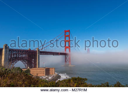 The Golden Gate Bridge surrounded by fog - Stock Photo