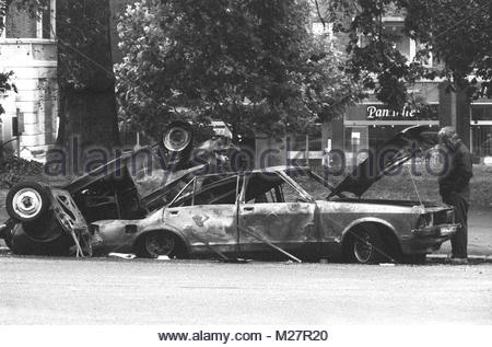 File photo dated 21/7/1982 of a police forensic expert examining the the scene in London's Hyde Park where four - Stock Photo