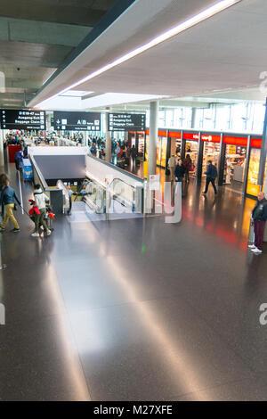 ZURICH, SWITZERLAND - DECEMBER 29, 2017: Kloten Airport or Zurich International Airport is the largest airport of - Stock Photo