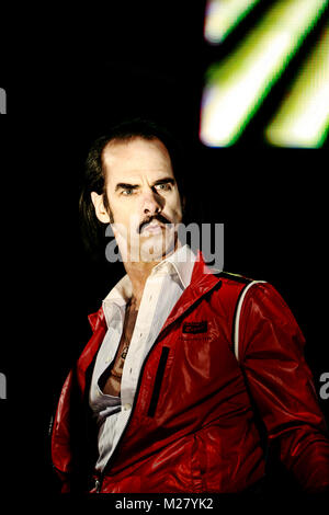 The alternative rock band Grinderman is here pictured with lead singer Nick Cave live on stage at a gig at Roskilde - Stock Photo