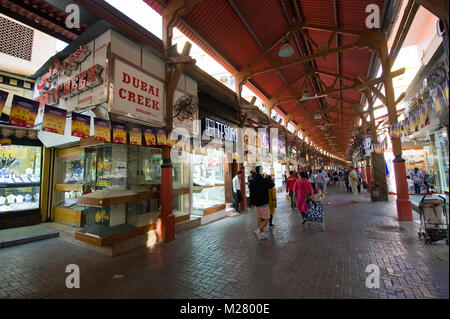 DUBAI, UNITED ARAB EMIRATES - JAN 02, 2018: City of gold is a bazaar in Dubai with a lot of shops who sell golden - Stock Photo