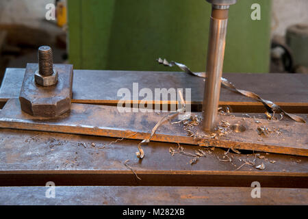 drilling machine in the working process, close-up - Stock Photo