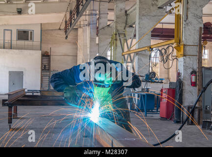 factory worker in welding workshop - Stock Photo