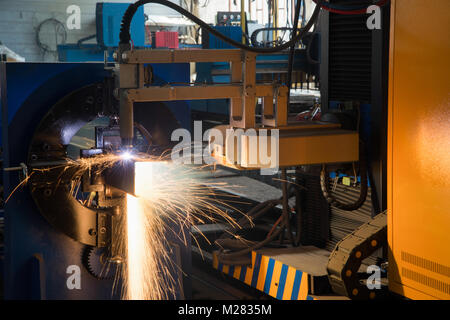 automatic laser machine cuts metal profile, close-up. pipe cutting system - Stock Photo