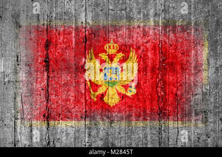 Montenegro flag painted on background texture gray concrete - Stock Photo