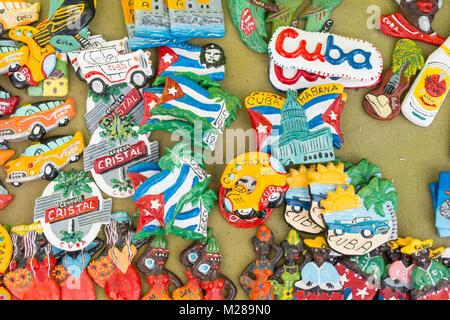 CIENFUEGOS, CUBA - JANUARY 3, 2017: Cuban national flags, palm, Che Guevera portraits and other fridge magnet / - Stock Photo