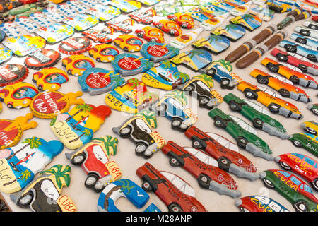 TRINIDAD, CUBA - JANUARY 4, 2017: Cuban national flags, palm, Che Guevera portraits and other fridge magnet / souvenirs - Stock Photo