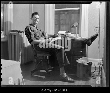 Arthur Miller working in New York City November 18, 1945. A leading American playwright of the Broadway stage, Miller's - Stock Photo
