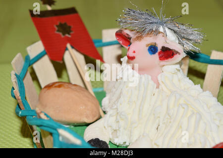 close up of marzipan Easter lamb and fruit in a basket - Stock Photo