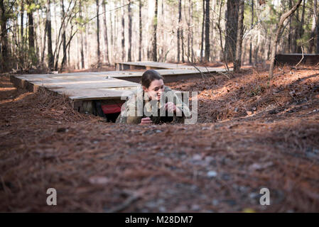 Spc. Michelle Green, combat medic, Medical Command, South Carolina Army National Guard, crawls out of an obstacle - Stock Photo