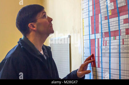 Yavoriv, Ukraine – Mark T. Esper, the United States Secretary of the Army reviews training documents during a visit - Stock Photo