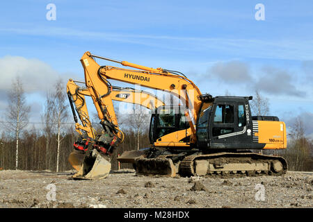 TURKU, FINLAND - APRIL 12, 2014: Cat and Hyundai Robex excavators at construction site. Marketshare Hyundai Heavy - Stock Photo