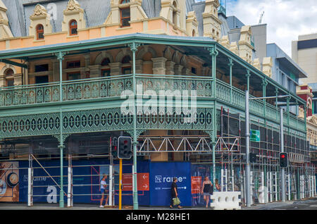 Cleaning Heritage Perth Buildings Reveals Amazing Bright Colors and extensive wrought iron work on balcony with - Stock Photo