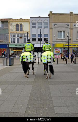Weston-super-Mare, UK. 6th February, 2018. Mounted police officers on patrol in the town centre. Avon and Somerset - Stock Photo