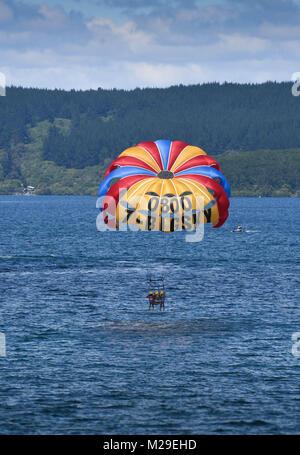 Paragliding on lake Taupo, New Zealand - Stock Photo