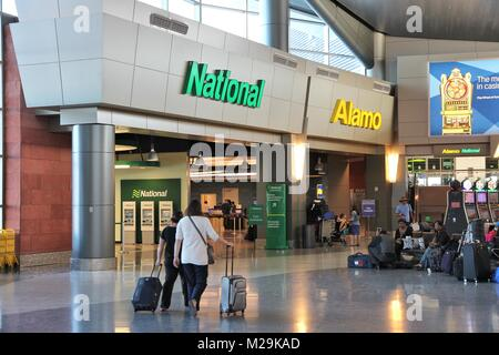 LAS VEGAS, USA - APRIL 13, 2014: Alamo and National car rental airport office in Las Vegas. Both brands are owned by Enterprise Holdings, company empl