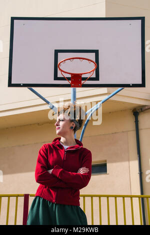 Young redhead woman with sport clothes doing exercise - Stock Photo
