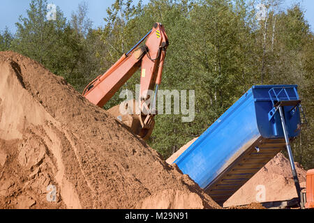Highway engineering; roadmaking, earthwork operations; ground work. Construction and road works. work of excavator - Stock Photo