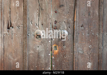 Part of old wooden door with keyhole - Stock Photo