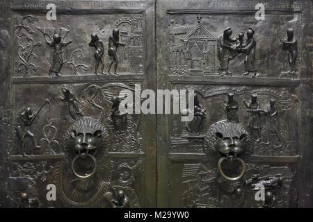 Romanesque bronze doorknockers of the Bernward Doors (Bernwardstür) from the 11th century in the Hildesheim Cathedral - Stock Photo