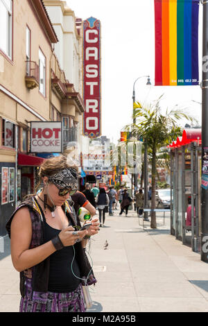 Woman using her phone. The Castro District. Aug, 2016. San Francisco, California, U.S.A. - Stock Photo