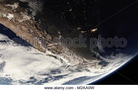 Digitally manipulated image of the Andes and city lights from space - Stock Photo