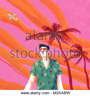 Man in sunglasses on tropical holiday against dramatic sky - Stock Photo