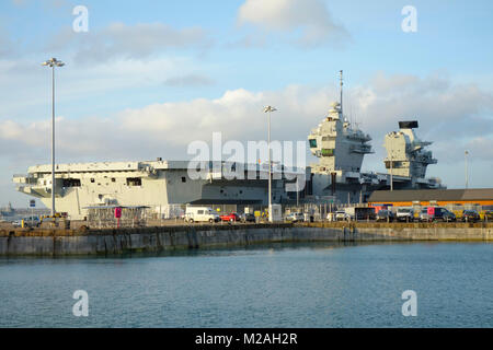 HMS Queen Elizabeth - Aircraft Carrier docked in HM Naval Base Portsmouth, Hampshire, United Kingdom - Stock Photo